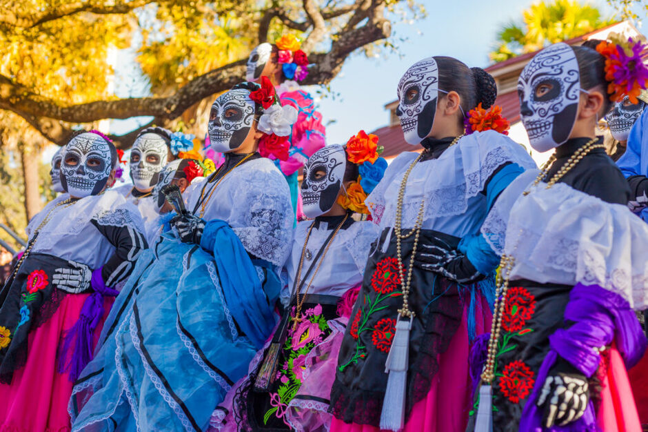 Group,Of,Unrecognizable,Women,Wearing,Traditional,Sugar,Skull,Masks,And