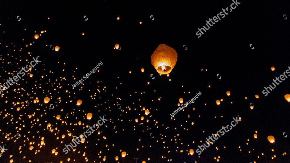 stock-photo-flying-lantern-in-the-night-sky-with-thousands-of-others-1397996195 (2)
